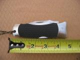 sog-tomcat-1-original-closed-against-ruler-length-un